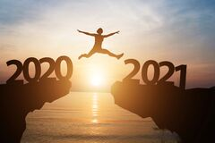 Free Man Jump From Year 2020 To 2021 With Sunlight And Sea. Starting Of New Year Concept Royalty Free Stock Photography - 184856477