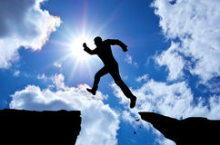 Man jump through the gap. Royalty Free Stock Photos