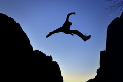 Man Jump through the Gap Stock Images