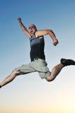 Man jump outdoor sunset Stock Images