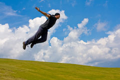 Man jump over meadow. In mountains royalty free stock photography