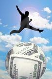 Man jump over money Stock Photos