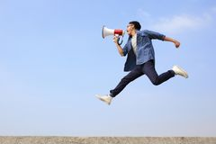 Man jump and shout megaphone Royalty Free Stock Photos