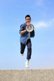Man jump and shout megaphone Stock Photography