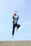 Man jump and shout megaphone. Man jump and shout by megaphone with blue sky background, asian Royalty Free Stock Images
