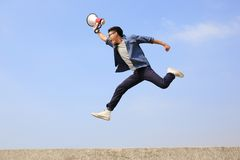 Man jump and shout megaphone. Man jump and shout by megaphone with blue sky background, asian Stock Photography