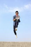 Man jump and shout megaphone Royalty Free Stock Photo