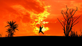 Man jump silhouette at sunset royalty free stock photography