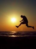Man jump on sunrise. Photograph captured on a very beautiful sunrise on the beach of Vama Veche, Romania Stock Photo