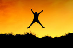 A man jump on the top of mountain Royalty Free Stock Image
