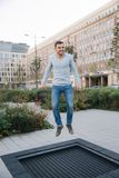Man jump on trampoline in centre of the city. Central park in Poland.  royalty free stock images