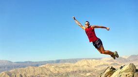 The man jumped. Stop the moment. The man jumped. Mountin view. Eilat. Israel Royalty Free Stock Images
