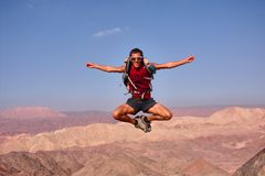 The man jumped. Stop the moment. The man jumped. Mountin view. Eilat. Israel Royalty Free Stock Photography