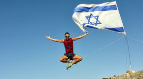 The man jumped. Stop the moment. The man jumped. Mountin view. Eilat. Israel Flag Royalty Free Stock Image