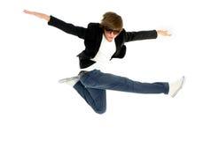 Man jumping. Studio shot of a young man jumping Royalty Free Stock Photography