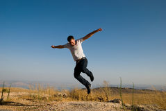 Man Jumping. Young active man making a big jump Royalty Free Stock Photography