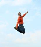 Man jumping. Happy expressive man jumping high and screaming Royalty Free Stock Photo