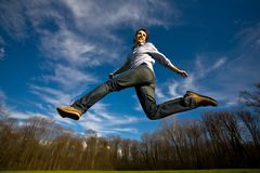 Man jumping. Young man jump in a field Stock Photography