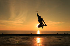 Man jumping against beautiful sunset. Freedom and enjoyment Royalty Free Stock Photo