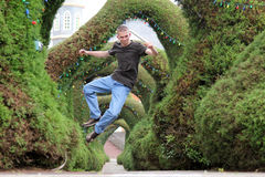 Man Jumping in Air. Man jumps in the air and kicks his feet together Royalty Free Stock Photos
