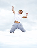 Man jumping in air against sky. Royalty Free Stock Photo