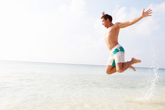 Man Jumping In The Air On Tropical Beach Royalty Free Stock Photo