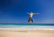 Man jumping on the beach Stock Photo