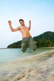 Man jumping on the beach Stock Image