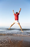 Man jumping on the beach Royalty Free Stock Photo