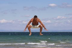 Man jumping on the beach. Stock Photography