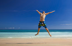 Man jumping on the beach Stock Photo