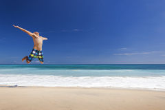Man jumping on the beach Stock Photos