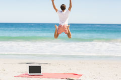 Man jumping on beach Royalty Free Stock Photography