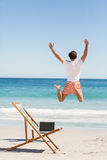 Man jumping on beach Royalty Free Stock Photo