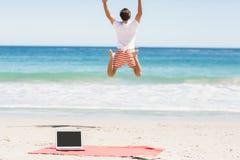 Man jumping on beach Stock Photo