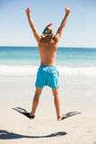 Man jumping on beach Royalty Free Stock Images