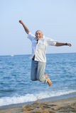 Man jumping on   beach Stock Photos