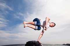 Man jumping on the beach on sky background Stock Photography