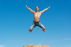 Man jumping on the blue sky background. A good time Royalty Free Stock Photos