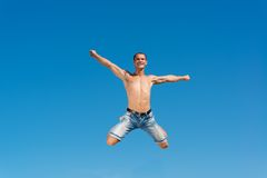Man jumping on the blue sky background. A good time Royalty Free Stock Photography