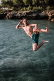 Man Jumping on Bodies of Water Stock Photos