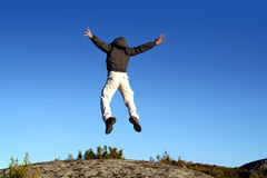 Man jumping from a cliff Stock Photography
