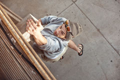 Man jumping and climbing. On wooden wall stock photo
