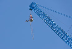 Man jumping from a crane Stock Image