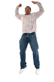 Man jumping with delight. Low angle view of young black man with arms outstretched jumping with delight, isolated on white background stock images