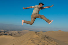 Man jumping desert peruvian coast Ica Peru Royalty Free Stock Photography