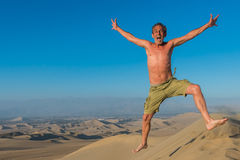 Man jumping desert peruvian coast Ica Peru Royalty Free Stock Images