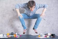 Man jumping on desktop Stock Photo