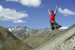 Man Jumping Down Rocky Slope Stock Photos