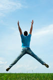 Man jumping on the field Royalty Free Stock Image